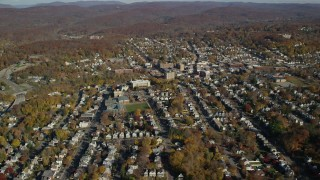 AX119_145 - 6K stock footage aerial video of small town residential neighborhoods in Autumn, Peekskill, New York
