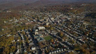 AX119_146 - 6K stock footage aerial video orbit small town residential neighborhoods in Autumn, Peekskill, New York