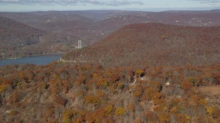 AX119_149 - 6K stock footage aerial video of forest in Autumn by the Hudson River, Westchester County, New York