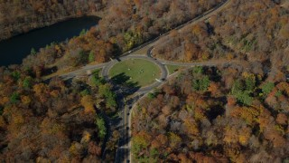 AX119_155 - 6K stock footage aerial video of a roundabout in Autumn, Highland Falls, New York
