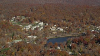 AX119_156 - 6K stock footage aerial video of condominium complexes overlooking pond in Autumn, Fort Montgomery, New York