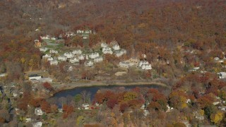 AX119_157 - 6K stock footage aerial video of condominium complexes by pond in Autumn, Fort Montgomery, New York