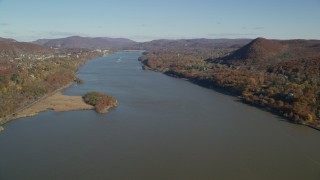 AX119_159 - 6K stock footage aerial video of following the Hudson River in Autumn, New York