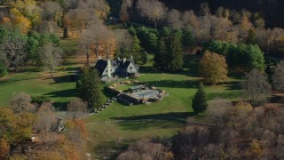 AX119_161 - 6K stock footage aerial video orbit isolated mansion in Autumn, Garrison, New York
