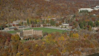 AX119_163 - 6K stock footage aerial video of Thayer Hotel in Autumn, West Point, New York