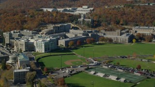 AX119_168 - 5.5K stock footage aerial video orbit the West Point Military Academy in Autumn, West Point, New York