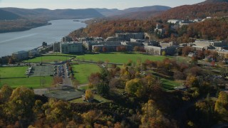 AX119_170 - 6K stock footage aerial video of orbiting around West Point Military Academy in Autumn, West Point, New York