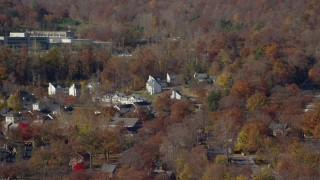 AX119_171 - 6K stock footage aerial video of housing at West Point Military Academy in Autumn, West Point, New York