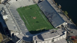 AX119_178 - 5.5K stock footage aerial video fly away from Michie Stadium at West Point Military Academy in Autumn, West Point, New York