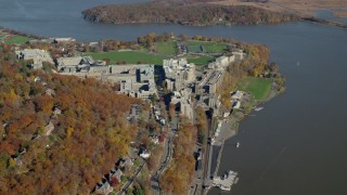 AX119_179 - 6K stock footage aerial video of the West Point Military Academy campus in Autumn, West Point, New York