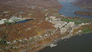 AX119_180 - 6K stock footage aerial video of a wide orbit around West Point Military Academy in Autumn, West Point, New York