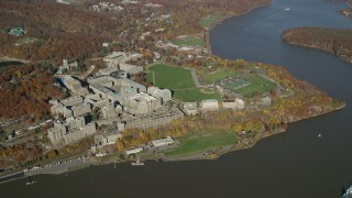 AX119_182 - 6K stock footage aerial video of a wide orbit by the campus of West Point Military Academy in Autumn, West Point, New York