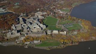 AX119_182E - 5.5K stock footage aerial video of a wide orbit by the campus of West Point Military Academy in Autumn, West Point, New York