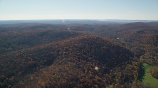 AX119_185 - 6K stock footage aerial video approaching hills with forests in Autumn, Garrison, New York