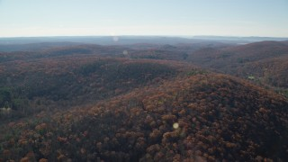 AX119_186 - 6K stock footage aerial video fly over hills with forests in Autumn, Garrison, New York