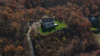 AX119_189 - 6K stock footage aerial video of flying over a hilltop home in Autumn, Garrison, New York