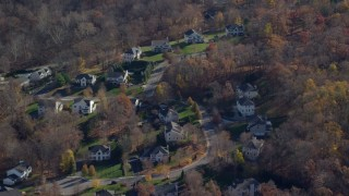 AX119_195 - 6K stock footage aerial video of a quiet residential neighborhood in Autumn, Mohegan Lake, New York