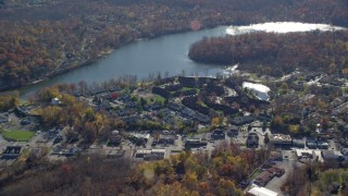 AX119_196 - 6K stock footage aerial video of lakeside row houses in Autumn, Mohegan Lake, New York