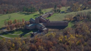 AX119_198 - 6K aerial stock footage video of a secluded hospital in Autumn, Mohegan Lake, New York