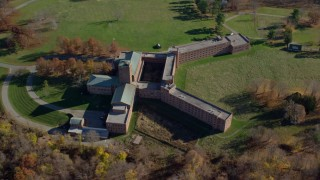 AX119_199 - 6K stock footage aerial video orbit a secluded hospital in Autumn, Mohegan Lake, New York