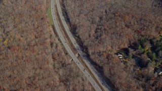 AX119_200 - 6K stock footage aerial video of forest highway in Autumn, Yorktown Heights, New York