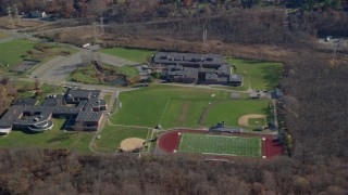 AX119_201 - 6K stock footage aerial video of middle and high schools in Autumn, Yorktown Heights, New York