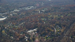 AX119_202 - 6K stock footage aerial video of suburban residential neighborhood in Autumn, Yorktown Heights, New York