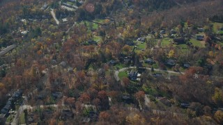 AX119_203 - 6K stock footage aerial video orbit suburban residential neighborhood in Autumn, Yorktown Heights, New York