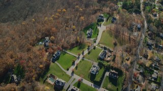 AX119_204 - 6K stock footage aerial video of a bird's eye view of suburban homes in Autumn, Yorktown Heights, New York