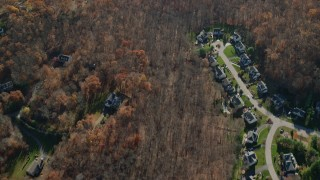 AX119_205 - 6K stock footage aerial video a bird's eye view of suburban homes in Autumn, Yorktown Heights, New York