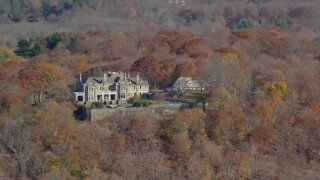 AX119_214 - 6K stock footage aerial video of an isolated hilltop mansion in Autumn, Mt Kisco, New York