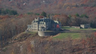 AX119_216 - 6K stock footage aerial video of an isolated mansion on a hill in Autumn, Mt Kisco, New York
