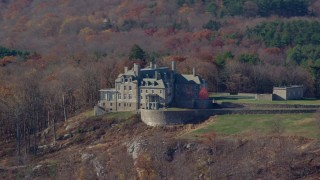 AX119_216E - 5.5K stock footage aerial video of an isolated mansion on a hill in Autumn, Mt Kisco, New York