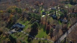 AX119_218 - 6K stock footage aerial video fly over upscale suburban neighborhood in Autumn, Mt Kisco, New York