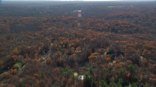 AX119_219 - 6K stock footage aerial video of flying over a rural neighborhood in Autumn, Mt Kisco, New York