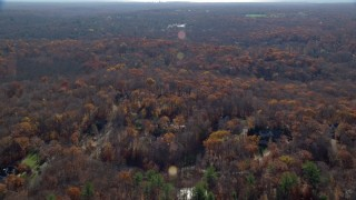 AX119_219E - 5.5K stock footage aerial video of flying over a rural neighborhood in Autumn, Mt Kisco, New York