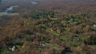 AX119_224 - 6K stock footage aerial video flyby upscale homes in Autumn, Greenwich, Connecticut