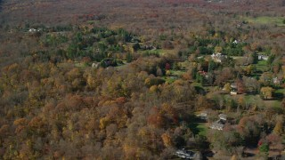 AX119_225 - 6K stock footage aerial video orbit upscale neighborhood in Autumn, Greenwich, Connecticut