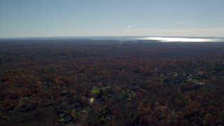AX119_226 - 6K stock footage aerial video of an upscale residential neighborhood in Autumn, Greenwich, Connecticut