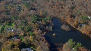 AX119_227 - 6K stock footage aerial video orbit waterfront mansions in Autumn, Greenwich, Connecticut