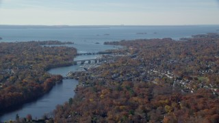AX119_229E - 5.5K stock footage aerial video of a small town community and bridges over river in Autumn, Greenwich, Connecticut