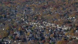 AX119_231 - 6K stock footage aerial video orbit a small town neighborhood in Autumn, Greenwich, Connecticut