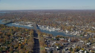 AX119_232 - 6K stock footage aerial video of a small town marina and neighborhood in Autumn, Greenwich, Connecticut