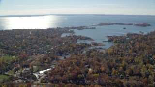AX119_233 - 6K stock footage aerial video of a small town waterfront neighborhood in Autumn, Greenwich, Connecticut