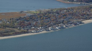 AX119_237 - 6K stock footage aerial video of small town beachfront homes in Autumn, Bayville, New York