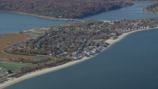 AX119_238 - 6K stock footage aerial video orbit is small town beachfront homes in Autumn, Bayville, New York