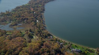 AX119_239 - 6K stock footage aerial video fly over oceanfront mansions in Autumn, Oyster Bay, New York