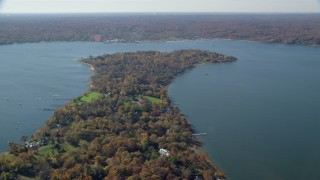 AX119_240 - 6K stock footage aerial video of oceanfront mansions in Autumn, Oyster Bay, New York