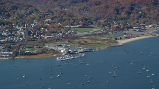 AX119_242 - 6K stock footage aerial video of an orbit of sailboats near a marina in Autumn, Oyster Bay, New York