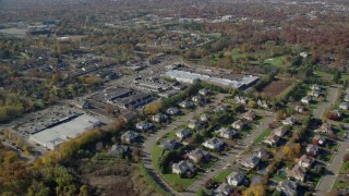 AX119_248 - 6K stock footage aerial video of a suburban neighborhood and strip mall in Autumn, Woodbury, New York
